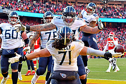 Jan 19, 2020; Kansas City, Missouri, USA; Tennessee Titans offensive tackle Dennis Kelly (71) reacts with offensive tackle Taylor Lewan (77) after catching a touchdown pass during the first half against the Tennessee Titans in the AFC Championship Game at Arrowhead Stadium. Mandatory Credit: Denny Medley-USA TODAY Sports