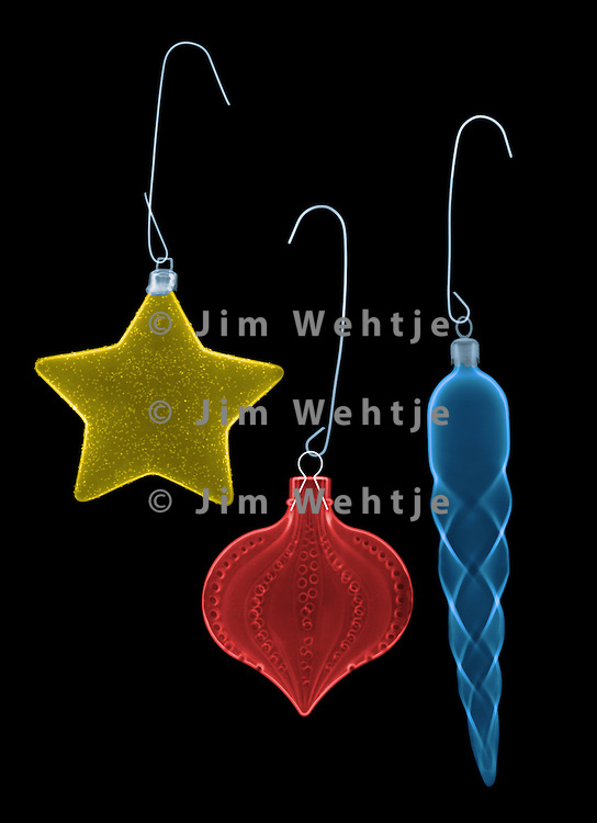 X-ray image of Xmas tree decorations (color on black) by Jim Wehtje, specialist in x-ray art and design images.