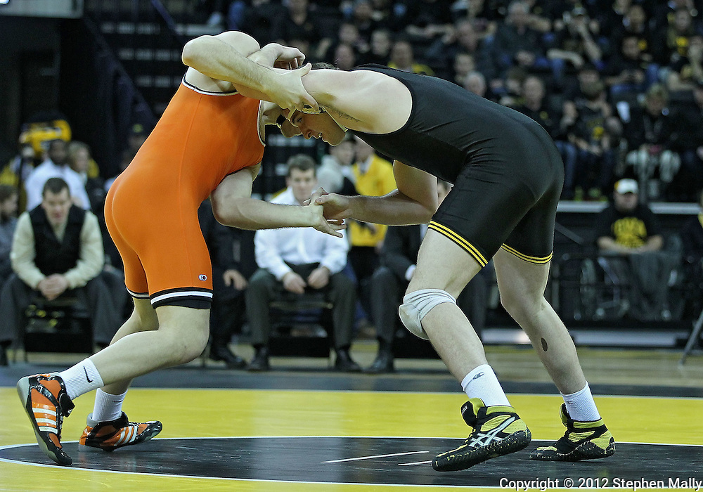 January 07, 2011: Oklahoma State's Alan Gelogaev and Iowa's Bobby Telford struggle for control during the heavyweight bout in the NCAA wrestling dual between the Oklahoma State Cowboys and the Iowa Hawkeyes at Carver-Hawkeye Arena in Iowa City, Iowa on Saturday, January 7, 2012. Gelogaev won 10-2.