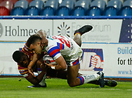 Mason Caton Brown of Wakefield Trinity tackled by Jermaine McGiillvary of Huddersfield Giants during the Ladbrokes Challenge Cup match at the John Smiths Stadium, Huddersfield<br /> Picture by Stephen Gaunt/Focus Images Ltd +447904 833202<br /> 11/05/2018