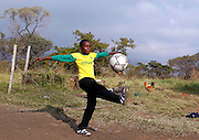 A South African boy plays soccer in Rustenberg June 10, 2010 before the 2010 Soccer World Cup kicks off. /Lee Jae-Won