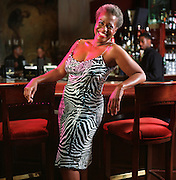 Portrait of former WSB TV anchorwoman Monica Kaufmann dressed in jazzy, dancing/party outfits for a night on the town at Justin's restaurant.