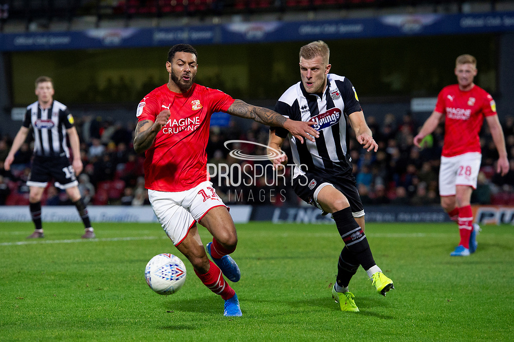 Cameron McGilp of Swindon Town during the EFL Sky Bet League 2 match between Grimsby Town FC and Swindon Town at Blundell Park, Grimsby, United Kingdom on 7 December 2019.