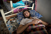 Sadam Hussein Hero, 20 years, in a improvised hospital in Gaziantep, Turkey. He lost a leg during the famous battle for the Kindi hospital in Aleppo. An explosive barrel landed 15 meters away from him, half December 2013. He was treated in a hospital in Aleppo and then in a hospital in Turkey where they amputated the leg. Before the war he worked as a furniture painter. He joined the jihad because it is an obligation for Muslims to protect the abused people. For the future he hopes to have a prosthesis and return to combat. He wants the victory of the people in Syria. After the victory he does not know what he will do. He is assisted by the Liwa Al-Tawhid in Gaziantep, who organized a translator to speak with the Turkish hospital staff. The Liwa Al-Tawhid has established its own medical service (Tawhid Medical Foundation) in Turkey.<br /> <br /> Sadam Hussein Hero, 20 ans, dans un hôpital improvisé a Gaziantep, Turquie. Il a perdu une jambe pendant la célèbre bataille du Kindi hôpital, à Alep. Un baril explosif est atterri à 15 mètres de distance de lui, mi décembre 2013. Il a été soigné dans un hôpital à Alep puis dans un hôpital en Turquie ou ils ont amputé la jambe. Avant la guerre il travaillait comme peintre de meubles. Il a rejoint le jihad car c'est une obligation pour des musulmans de protéger le peuple maltraité. Pour son avenir il espère avoir une prothèse et revenir au combat. Il souhaite la victoire du peuple en Syrie. Apres la victoire il ne sait pas qu'est ce qu'il va faire. Il est pris en charge par le Liwa Al-Tawhid à Gaziantep, qui a organisé des traducteurs pour parler avec le personnel turque. Le liwa al-tawhid a mis en place son propre service médical (Tawhid Medical Foundation) en Turquie.