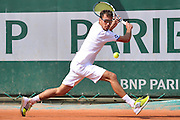 Jerzy Janowicz from Poland competes in men's single first round while Day First during The French Open 2014 at Roland Garros Tennis Club in Paris, France.<br /> <br /> France, Paris, May 25, 2014<br /> <br /> Picture also available in RAW (NEF) or TIFF format on special request.<br /> <br /> For editorial use only. Any commercial or promotional use requires permission.<br /> <br /> Mandatory credit:<br /> Photo by &copy; Adam Nurkiewicz / Mediasport