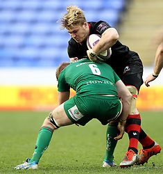 Edinburgh's David Denton is tackled by London Irish's Conor Gilsenan - Photo mandatory by-line: Robbie Stephenson/JMP - Mobile: 07966 386802 - 05/04/2015 - SPORT - Rugby - Reading - Madejski Stadium - London Irish v Edinburgh Rugby - European Rugby Challenge Cup