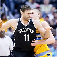 04 March 2016: Brooklyn Nets center Brook Lopez (11) posts up Denver Nuggets center Nikola Jokic (15) during the Brooklyn Nets 121-120 victory over the Denver Nuggets, at the Pepsi Center, Denver, Colorado, USA.