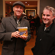 Doug Walker, left, and Rob Murphrey pose for a picture Sunday December 21, 2014 during the Brooklyn Arts District Christmas party at Canape in Wilmington, N.C. (Jason A. Frizzelle)