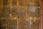 Names carved into a wall at Eton College boarding school, UK.