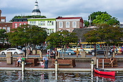 """Annapolis, Maryland - June 05, 2016: People congregate at the Kunta Kinte-Alex Haley Memorial park in the touristy City Dock park area of historic Annapolis Sunday June 5th, 2016.  Earlier that day a perigean spring tide brought some of the highest water levels of the year to the coastal town and partially flooded the park.<br /> <br /> <br /> A perigean spring tide brings nuisance flooding to Annapolis, Md. These phenomena -- colloquially know as a """"King Tides"""" -- happen three to four times a year and create the highest tides for coastal areas, except when storms aren't a factor. Annapolis is extremely susceptible to nuisance flooding anyway, but the amount of nuisance flooding has skyrocketed in the last ten years. Scientists point to climate change for this uptick. <br /> <br /> <br /> CREDIT: Matt Roth for The New York Times<br /> Assignment ID: 30191272A"""