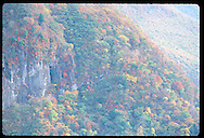 Fall-colored trees carpet steep slopes and cliffs of the Nikko mountain region; Lake Chuzenji. Japan