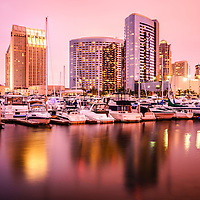 Photo of San Diego at night with with skyline and Embarcadero Marina luxury boats. Image is high resolution and was taken in 2012.