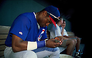 June 27th 1998 Kansas City, MO.Cubs right fielder Sammy Sosa holds an injured bird that was found underneath the bench in the dugout before an interleague game at Kauffman Stadium. Photo by Chris Machian