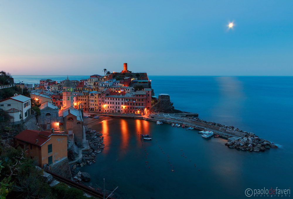 A view of Vernazza bathed in the moonlight. Taken about 30 minutes before sunrise from the trail that from Vernazza goes to Monterosso al Mare in the Cinque Terre, Italian Riviera, Italy