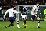 Preston North End Defender Greg Cunningham battles with Birmingham City midfielder Demarai Gray  during the Sky Bet Championship match between Preston North End and Birmingham City at Deepdale, Preston, England on 15 December 2015. Photo by Pete Burns.