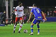 Matthew Olosunde takes on Paul McCallum during the The FA Cup match between Solihull Moors and Rotherham United at the Automated Technology Group Stadium, Solihull, United Kingdom on 2 December 2019.