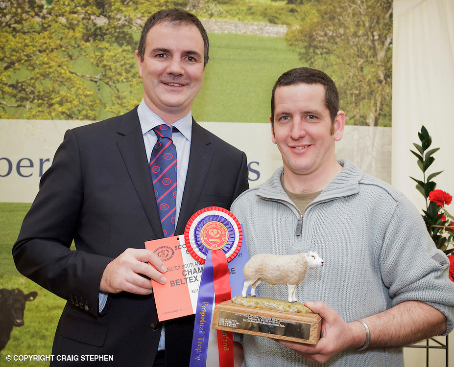 Scottish National Premier Meat Exhibition & competition to promote Scottish livestock from farm to consumer, sponsored by Marks & Spencer. Held at Scotbeef Ltd, Bridge of Allan, Saturday 19th Novermber, 2011...Malcolm Copland, head of trading at Marks & Spencer presents Andrew Baillie, Carstairs Mains, Lanark - champ beltex carcase