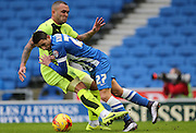 Brighton striker, Anthony Knockaert (27) tangles with Huddersfield Town defender Joel Lynch (33) during the Sky Bet Championship match between Brighton and Hove Albion and Huddersfield Town at the American Express Community Stadium, Brighton and Hove, England on 23 January 2016.