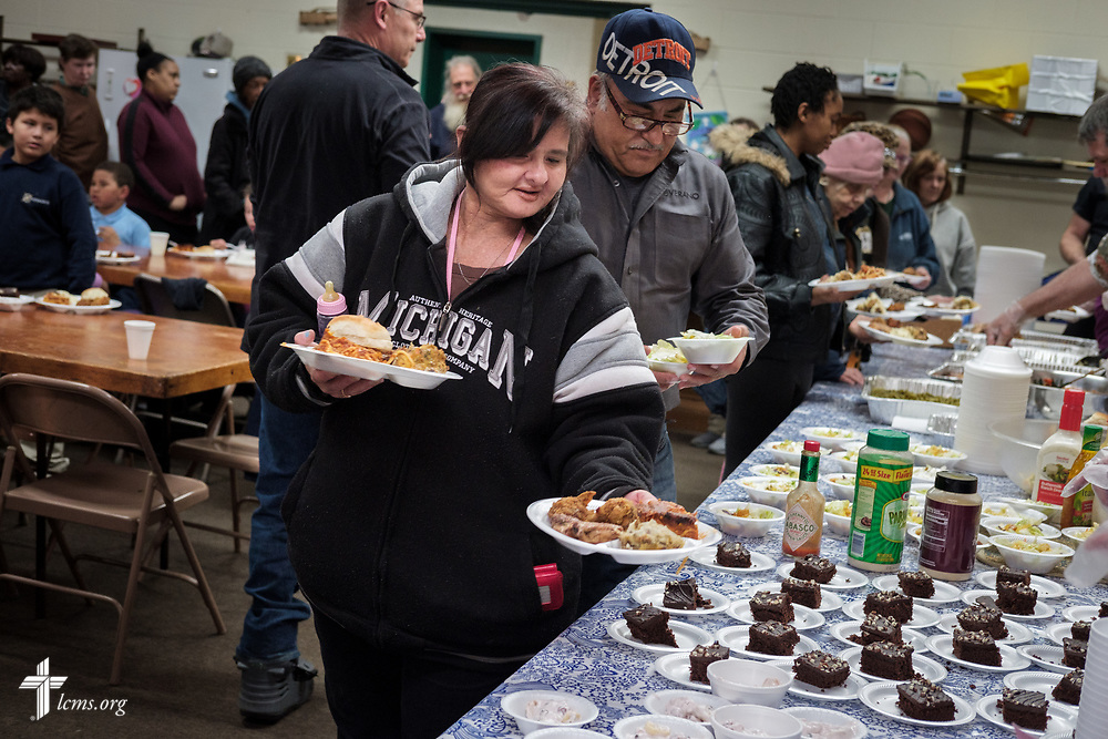 Guests receive food for the daily dinner meal at Family of God on Wednesday, March 28, 2018, in Detroit. LCMS Communications/Erik M. Lunsford