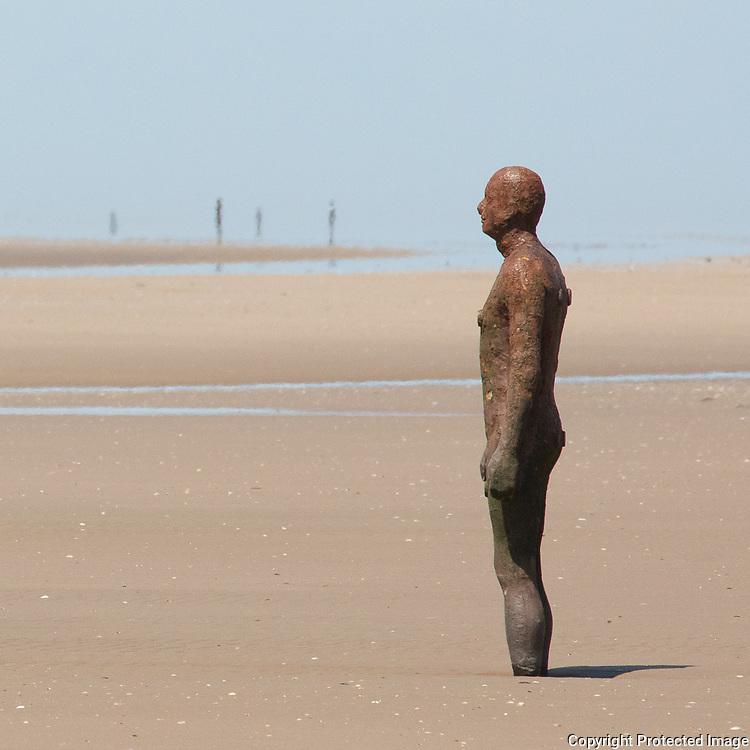 Another Place cast iron figure based on Antony Gormley's own body, Crosby Beach, Merseyside.