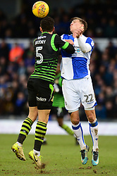 Joe Partington of Bristol Rovers challenges for the header with Mathieu Baudry - Mandatory by-line: Dougie Allward/JMP - 23/12/2017 - FOOTBALL - Memorial Stadium - Bristol, England - Bristol Rovers v Doncaster Rovers - Skt Bet League One