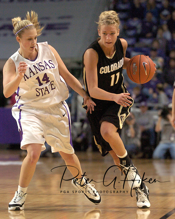 Colorado guard Hannah Skildum (R) drives up the sideline past Kansas State's Claire Coggins (L) during the first half of K-State's 85-66 win over the Buffaloes at Bramlage Coliseum in Manhattan, Kansas, January 14, 2006.