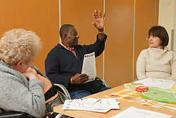 Clients attending discussion group on Healthy Eating at a resource for people with physical and sensory impairment.
