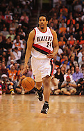 Mar. 21 2010; Phoenix, AZ, USA; Portland Trailblazers guard Andre Miller (24) dribbles the ball down the court in the first half at the US Airways Center.   Mandatory Credit: Jennifer Stewart-US PRESSWIRE.