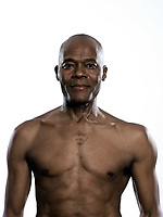 Portrait of a shirtless Afro American man in studio on white isolated background