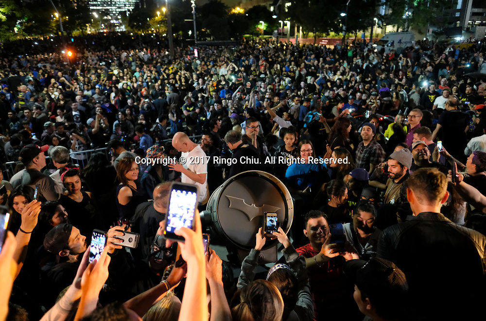People crowd as the Bat-signal is projected onto Los Angles City Hall during a tribute to pop-culture icon Adam West in Los Angeles, June15, 2017.(Photo by Ringo Chiu)<br /> <br /> Usage Notes: This content is intended for editorial use only. For other uses, additional clearances may be required.
