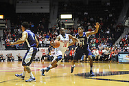 """Ole Miss Rebels guard Ladarius White (10) vs. TCU Horned Frogs forward Brandon Parrish (11) at the C.M. """"Tad"""" Smith Coliseum in Oxford, Miss. on Thursday, December 4, 2014. TCU won 66-54."""