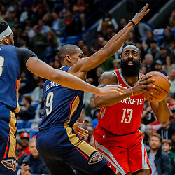 Jan 26, 2018; New Orleans, LA, USA; Houston Rockets guard James Harden (13) is defended by New Orleans Pelicans guard Rajon Rondo (9) and forward Anthony Davis (23) during the first quarter at the Smoothie King Center. Mandatory Credit: Derick E. Hingle-USA TODAY Sports