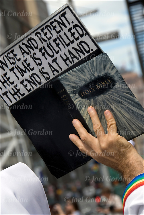 "Repent your Sins. hand holding sign with the bible ""We Wise and Repent. The Time is Fulfilled. The End is at Hand"" on street during 9-11-11."