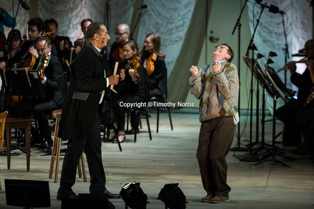 "Ashraf Sewailam (bass-baritone) as ""Commendatore"" and Keith Jameson (tenor) as ""Snibblesworth"" in the world premiere of Steven Stucky and Jeremy Denk's The Classical Style: An Opera (of Sorts) at the 68th Ojai Music Festival at Libbey Bowl on June 13, 2014 in Ojai, California."