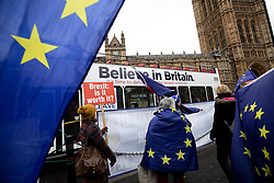 © Licensed to London News Pictures. 05/12/2018. London, UK. Pro-Brexit and Anti-Brexit demonstrators campaign next to each other outside parliament, as a bus with the slogan 'Believe in Britain' drives past. This week MPs are debating the withdrawal deal ahead of a vote on the 11 December. Photo credit : Tom Nicholson/LNP
