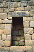 "The Incas finely crafted this stone alcove in a wall at Machu Picchu, a magnificent archeological site in the Cordillera Vilcabamba, Andes mountains, Peru, South America. Machu Picchu was built around 1450 AD as an estate for the Inca emperor Pachacuti (14381472). Spaniards passed in the river valley below but never discovered Machu Picchu during their conquest of the Incas 1532-1572. The outside world was unaware of the ""Lost City of the Incas"" until revealed by American historian Hiram Bingham in 1911. Machu Picchu perches at 2430 meters elevation (7970 feet) on a well defended ridge 450 meters (1480 ft) above a loop of the Urubamba/Vilcanota River ( Sacred Valley of the Incas). UNESCO honored the Historic Sanctuary of Machu Picchu on the World Heritage List in 1983."