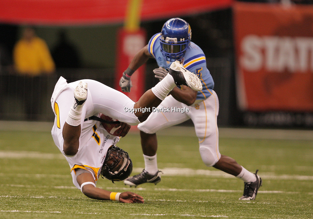 2008 November, 29: Grambling State quarterback Greg Dillon (1) trips during a run as Southern University defensive back Glenn Bell (5) closes in during the first half of the 35th annual State Farm Bayou Classic between Southern University and Grambling State University at the Louisiana Superdome in New Orleans, LA.  .
