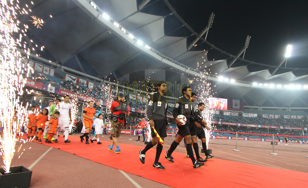 Match Raferee entering the field during match 16 of the Hero Indian Super League between The Delhi Dynamos FC and NorthEast United FC held at the Jawaharlal Nehru Stadium, Delhi, India on the 29th October 2014.<br /> <br /> Photo by:  Arjun Panwar/ ISL/ SPORTZPICS
