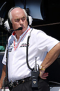 Indy Car team owner Roger Penske watches the action on the track during practice and qualifications for the Indy 500 on May 12, 2007.
