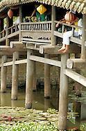 people resting at vietnamese bridge