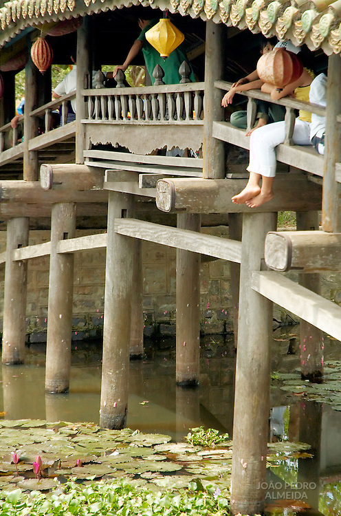 people resting at vietnamese bridge