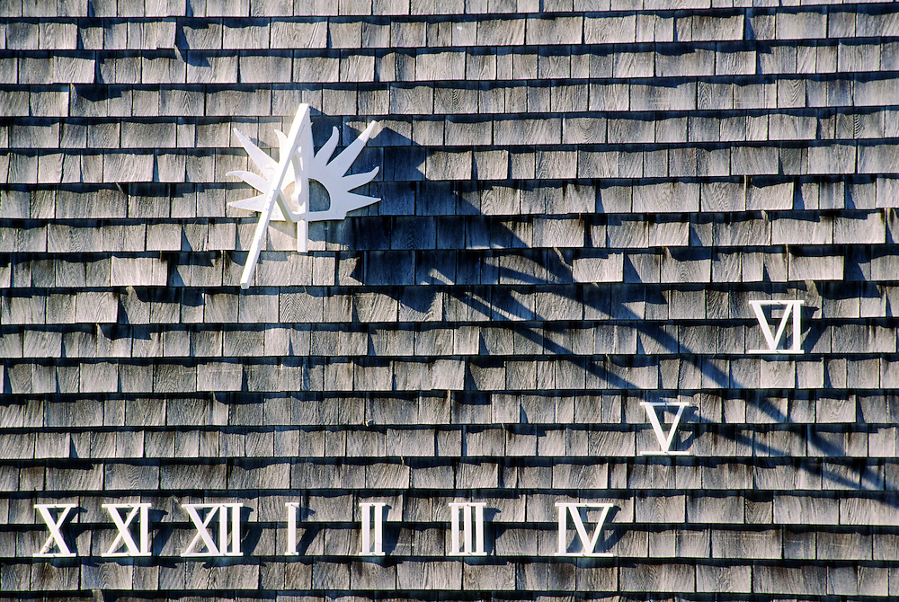 Sundial on shingle wall of cottage in village of Siasconset on island of Nantucket, off Cape Cod, Massachusetts, USA