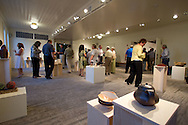 People look at artwork on display from The Ceramics Center at the CSPS Hall Grand Re-opening in Cedar Rapids on Friday evening, August 26, 2011. About 190 people attended the event which featured a concert by Susan Werner.