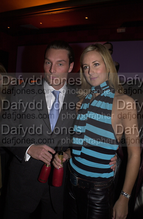 Seb Bishop and Lady Victoria Hervey. Glamour magazine launch party. Red Cube. 6 March 2001. © Copyright Photograph by Dafydd Jones 66 Stockwell Park Rd. London SW9 0DA Tel 020 7733 0108 www.dafjones.com