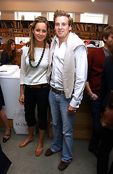 HARRY & CHARLOTTE LAWSON-JOHNSTON at a private view of 'The Living is Easy' an exhibition of contemporary photography held at Flowers East, 82 Kingsland Road, London E2 on 10th August 2006.<br />