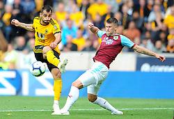 Johann Gudmundsson of Burnley blocks a shot from Leo Bonatini of Wolverhampton Wanderers- Mandatory by-line: Nizaam Jones/JMP- 16/09/2018 - FOOTBALL - Molineux - Wolverhampton, England - Wolverhampton Wanderers v Burnley - Premier League