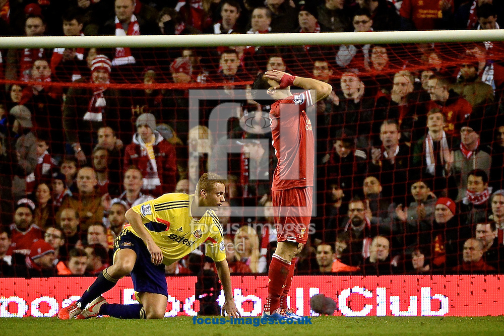 Luis Su&aacute;rez of Liverpool is disappointed after missing a chance during the Barclays Premier League match at Anfield, Liverpool<br />