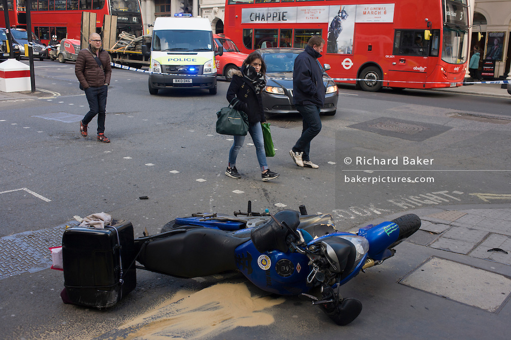 Aftermath of collision between a licensed minicab and a courier bike in Haymarket, central London.