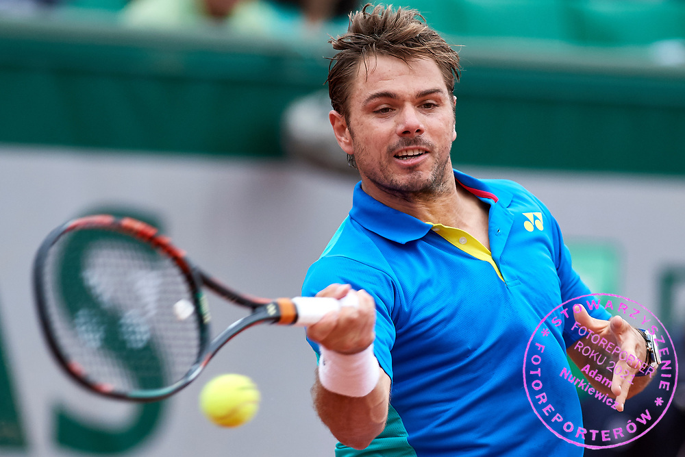 Paris, France - 2017 June 03: Stan Wawrinka from Switzerland plays a forehand while his men's single match third round during tennis Grand Slam tournament The French Open 2017 (also called Roland Garros) at Stade Roland Garros on June 03, 2017 in Paris, France.<br /> <br /> Mandatory credit:<br /> Photo by &copy; Adam Nurkiewicz<br /> <br /> Adam Nurkiewicz declares that he has no rights to the image of people at the photographs of his authorship.<br /> <br /> Picture also available in RAW (NEF) or TIFF format on special request.<br /> <br /> Any editorial, commercial or promotional use requires written permission from the author of image.