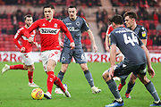 Middlesbrough midfielder Mo Besic (37) on the ball under pressure from Millwall defender Ben Marshall (44) as Millwall midfielder Shaun Williams (6) watches on during the EFL Sky Bet Championship match between Middlesbrough and Millwall at the Riverside Stadium, Middlesbrough, England on 19 January 2019.